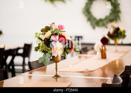 Flower centerpieces on a table on natural lightning conditions Stock ...