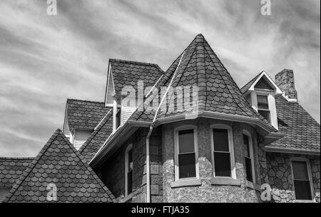 Black and white old Victorian house rooftop, Middlesex County, New Jersey, USA, abstract shapes building rooftop - Stock Photo