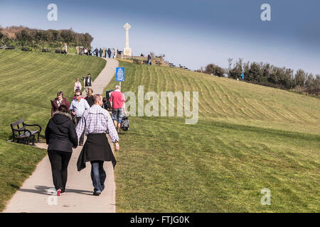 People enjoy an afternoon stroll along the path leading up to the War Memorial in Chapel Stile Field in Padstow, - Stock Photo
