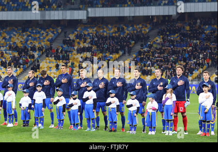 Kyiv, Ukraine. 28th March, 2016. Players of National football team of Ukraine sing National anthem before Friendly - Stock Photo