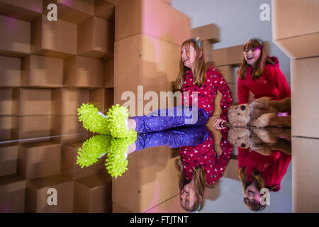 Aberystwyth Wales UK, March 29 2016  Children on Easter holiday playing in and with the enormous 'Hollow'  installation - Stock Photo