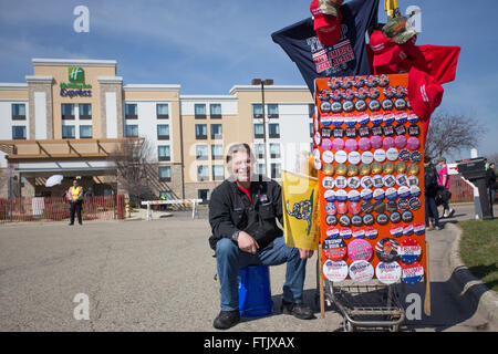 Milwaukee, WI. March 29th, 2016. Donald J. Trump supporter sits in front of the Janesville Holiday Inn Express with - Stock Photo