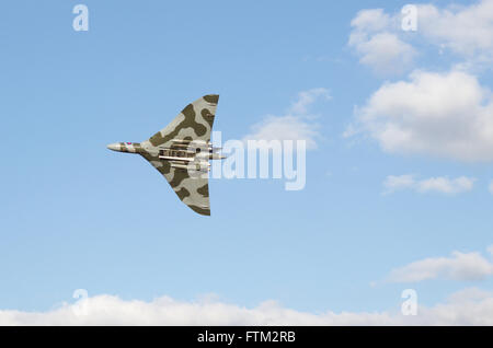 The Avro Vulcan Bomber performing a display in clear blue skies completing its final flight - Stock Photo