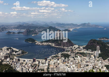 Beach and cove of Botafogo in Guanabara Bay with Pao de Acucar and Morro da Urca in the background - Stock Photo