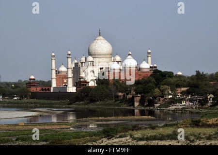 Mausoleum Taj Mahal seen from the Agra Fort - Jamuna or Yamuna River in foreground - Stock Photo