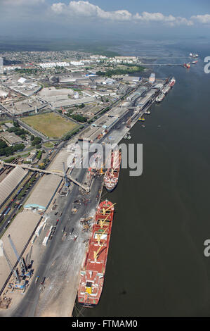 Aerial view of cargo ships moored in the harbor on the edge of Paranagua Bay - Stock Photo