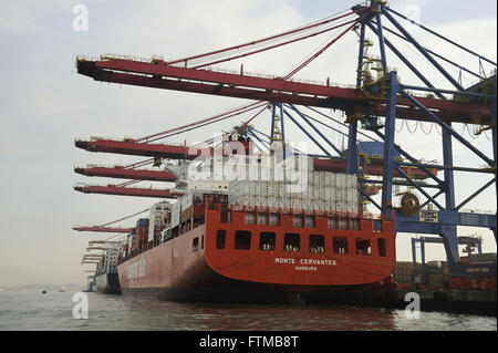 Cargo ship being loaded at the Port of Santos - Stock Photo