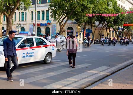 Busy street traffic in Hanoi, Vietnam - Stock Photo