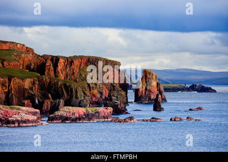 The Drongs red sandstone sea stacks in Braewick on stunning rugged Scottish Shetland coastline landscape Eshaness - Stock Photo