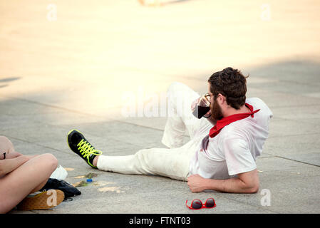 Spain Navarra Pamplona 10 July 2015 S Firmino fiesta a boy lying on the sidewalk during the festival, for s Firmino - Stock Photo