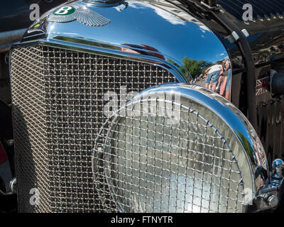 Merano, Italy - July 9, 2015: headlights and grille of the Bentley speed six in Merano during the South Tyrol classic - Stock Photo