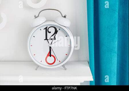 Analog desktop hours. It is on a table in room - Stock Photo