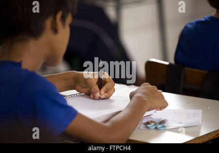 Student in class writing in rural school ESE Inacio de Loyola district of New London - Stock Photo