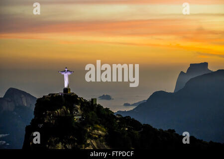 Aerial view of Christ the Redeemer on Corcovado Mountain at dusk - Stock Photo
