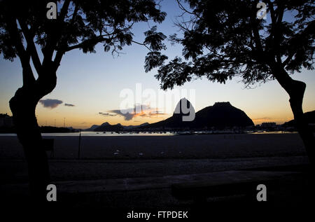 Dawn on Botafogo Beach with Morro do Pao de Acucar and Morro da Urca in the background - Stock Photo