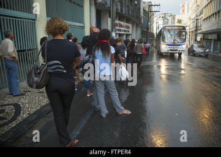 People waiting for the bus on the street Carlos Gomes on rainy days - Centro Historico - Stock Photo