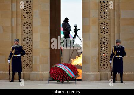 BAKU, AZERBAIJAN - JANUARY 20 2014 Honour guard at monument in Baku, Azerbaijan, on the anniversary of the civilian - Stock Photo