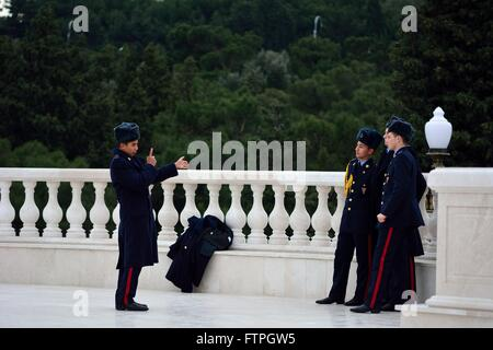 BAKU, AZERBAIJAN - JANUARY 20 2014 Azerbaijani cadet positioning fellow young soldiers ahead of a photo - Stock Photo