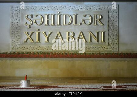 BAKU, AZERBAIJAN - JANUARY 20 2014 Valley of Martyrs' written in Azerbaijani at national monument, with flowers - Stock Photo