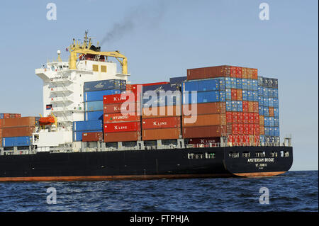 Cargo ship loaded with containers in Guanabara Bay - Stock Photo