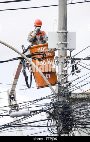 Worker doing maintenance of the power grid - Stock Photo