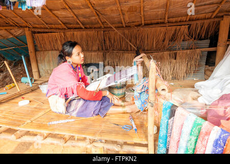 Woman weaving on loan at the Longneck people and Hill Tribe of Northern Thailand the long neck people in Palong - Stock Photo