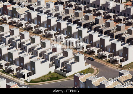 Aerial view of houses with panels capture solar energy in housing - Stock Photo