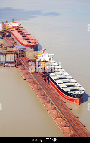 Aerial view of ships being loaded with iron ore - Stock Photo