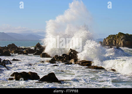Ocean waves crashing on the rocks of the beach Armacao - south of the island - Stock Photo