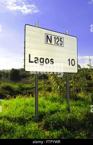 A road sign stating the distance to the town of Lagos in the Algarve region, Portugal. - Stock Photo