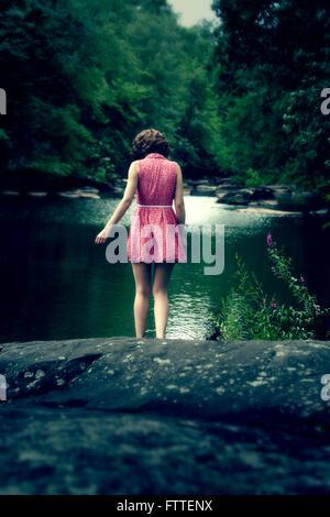 Woman in short dress at lake - Stock Photo