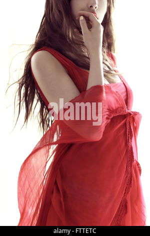 Brunette in red dress - Stock Photo