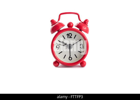 Red vintage alarm clock isolated on white background - Stock Photo