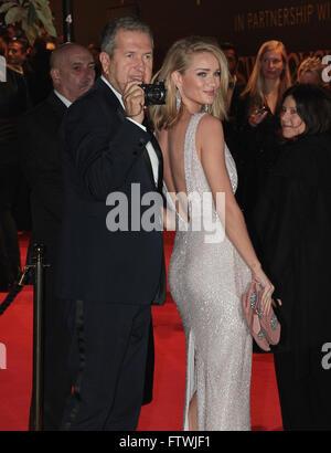 London, UK, 23rd Nov 2015: Rosie Huntington-Whiteley and Mario Testino attend the British Fashion Awards at the - Stock Photo
