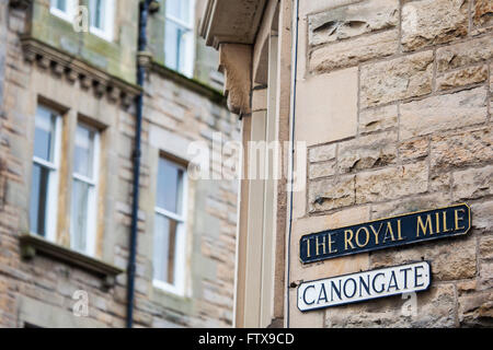 The street signs for Canongate and The Royal Mile in the historic city of Edinburgh, Scotland. - Stock Photo