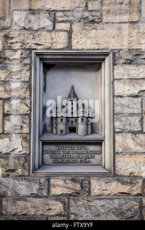 A carving on The Royal Mile in Edinburgh marking the location where the Netherbow Port once stood. - Stock Photo