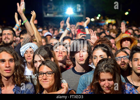 BENICASSIM, SPAIN - JULY 18: Crowd in a concert at FIB Festival on July 18, 2014 in Benicassim, Spain. - Stock Photo