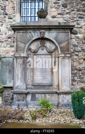 EDINBURGH, SCOTLAND - MARCH 12TH 2016: The grave of famous Scotsman Adam Smith at Canongate Kirkyard in Edinburgh, - Stock Photo