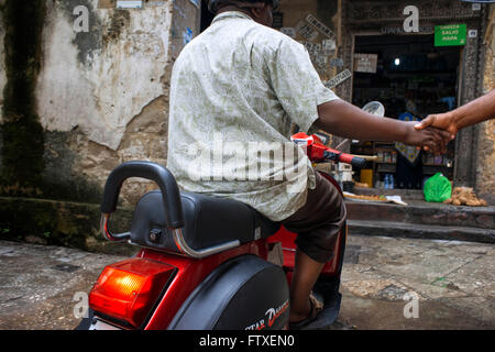 Classic vespa scooter in one of Stone Town s maze of narrow streets, Zanzibar, Tanzania. - Stock Photo