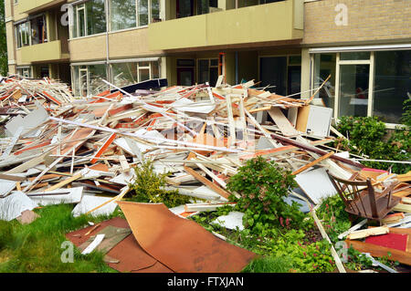 Demolition. Door and window frames stack of a deconstructed building - Stock Photo