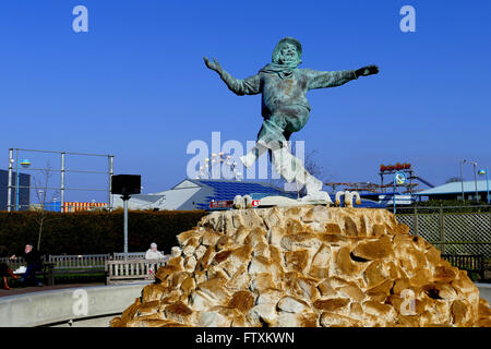 SKEGNESS, LINCOLNSHIRE, UK. MARCH 17. 2016.  The famous symbol of the Jolly Fisherman with the funfair behind at - Stock Photo