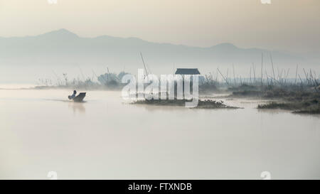 Silhouette of a man in speedboat, Inle Lake, nyaungshwe, Myanmar - Stock Photo