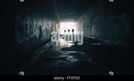 Silhouettes of three people in Sixth Street Tunnel, Los angeles, California, America, USA - Stock Photo