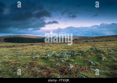 Dramatic clouds over wild moorland landscape in Devon, UK - Stock Photo