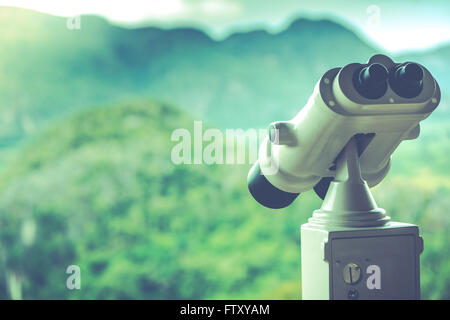Vintage toned photo of landscape binoculars overlooking mountains - Stock Photo
