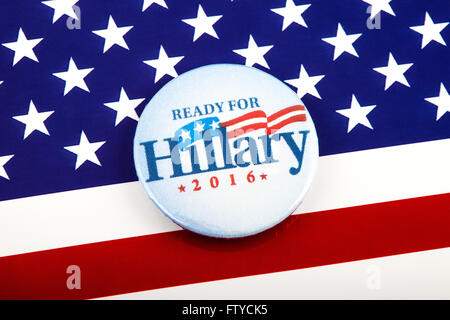 A Hillary Clinton 2016 pin badge over the US flag symbolizing her campaign to become the next President of the USA. - Stock Photo