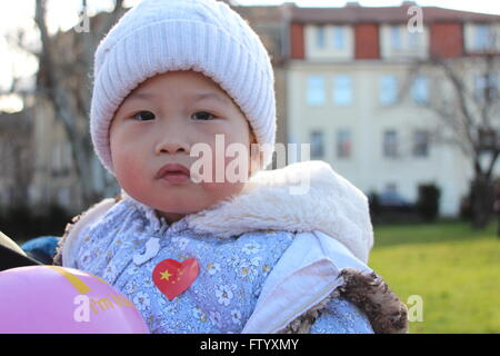 Prague, Czech Republic. 29th Mar, 2016. This is a Chinese baby who was one of the Chinese nationals of all kinds - Stock Photo