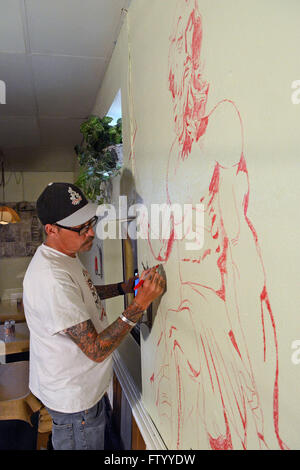 Albuquerque, NM, USA. 29th Mar, 2016. Award winning muralist Dave Briggs draws a picture of Neptune for the mural - Stock Photo