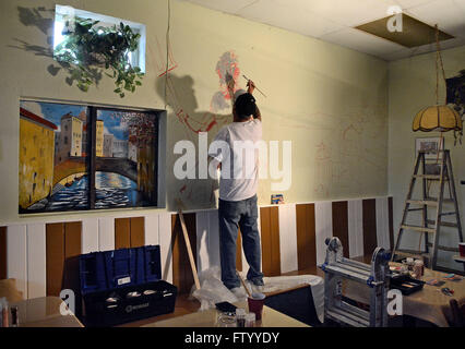 Albuquerque, NM, USA. 29th Mar, 2016. Award winning muralist Dave Briggs paints a mural inside of the new Olive - Stock Photo