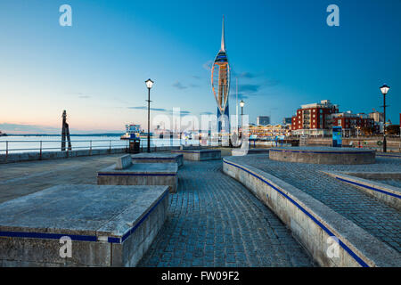 Night falls at Spice Island in Old Portsmouth, UK. Spinnaker Tower in the distance. - Stock Photo